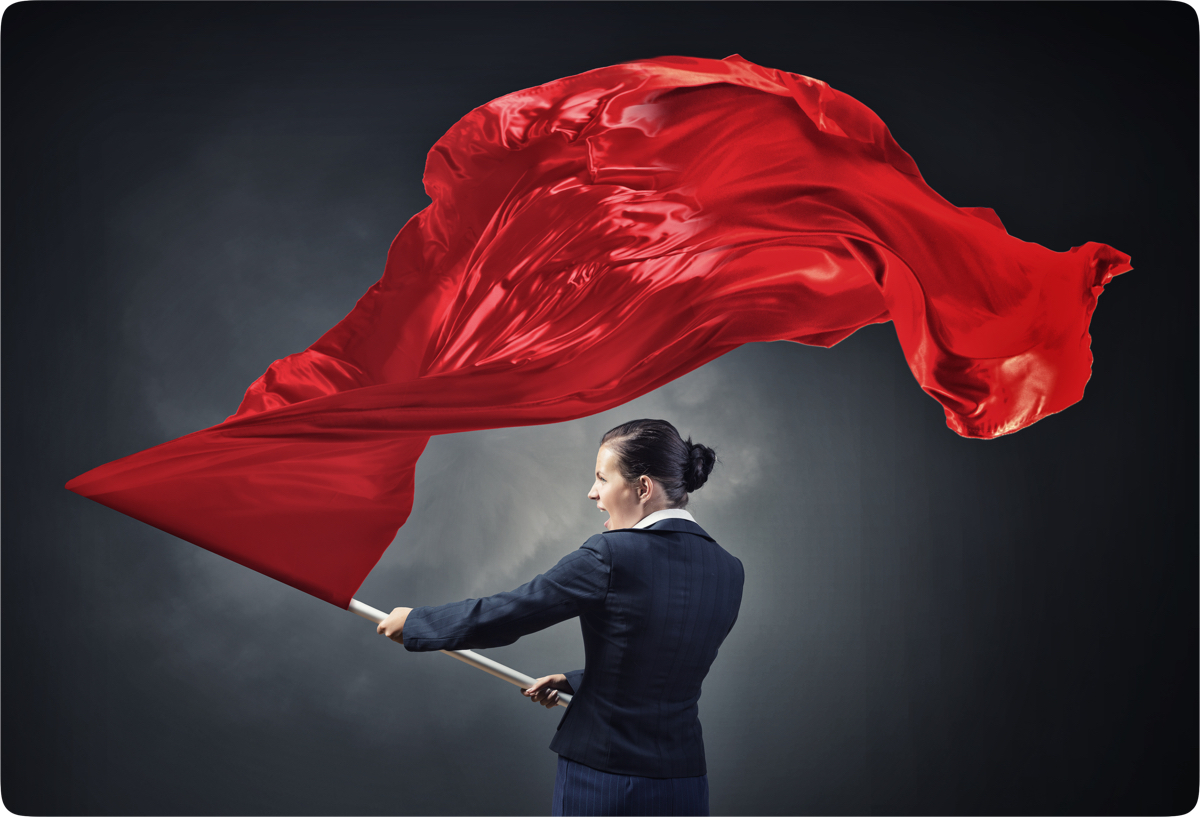 A woman waving a red flag of warning